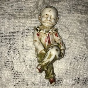 Old creepy porcelain or ceramic clown
